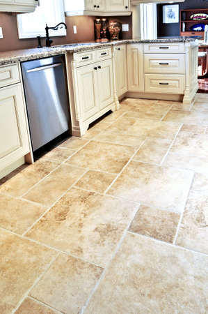 expensive granite: Ceramic tile floor in a modern luxury kitchen
