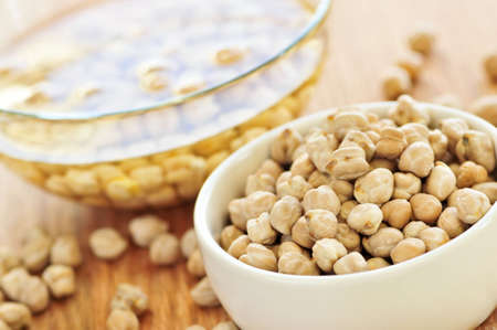 soaking: Chickpeas dried in a bowl and soaking in water Stock Photo