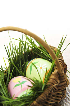 Easter eggs arrangement with green grass in a basket Stock Photo - 3931506