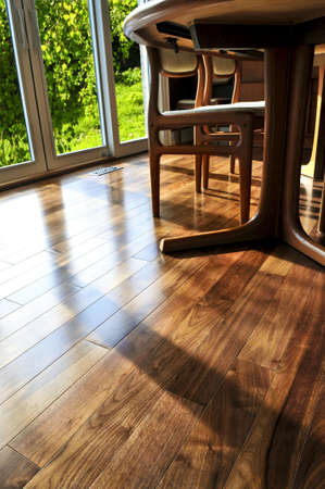 wood flooring: Hardwood walnut floor in residential home dining room