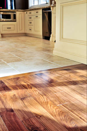 tile flooring: Hardwood and tile floor in residential home kitchen and dining room