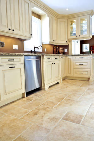 Ceramic tile floor in a modern luxury kitchen photo