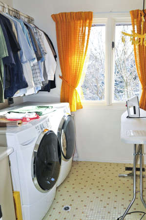Laundry room with modern washer and dryer photo