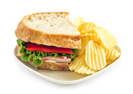 Sandwich with potato chips isolated on white background photo