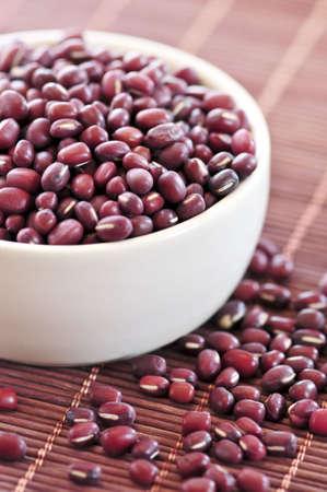 adzuki: Dry red adzuki beans in a bowl