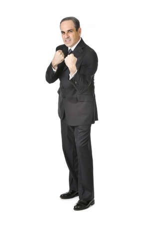 Businessman in a suit ready to fight isolated on white background photo