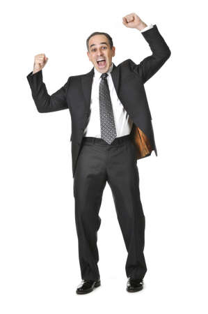 victorious: Triumphant businessman in a suit isolated on white background