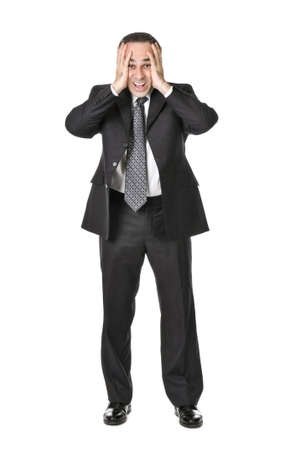 desperate face: Businessman in a suit being upset isolated on white background