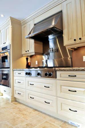 Interior of modern luxury kitchen with stainless steel appliances photo