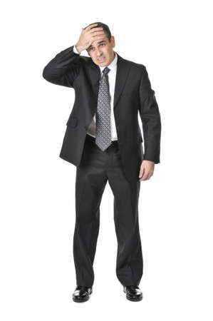 fear of failure: Upset businessman in a suit isolated on white background