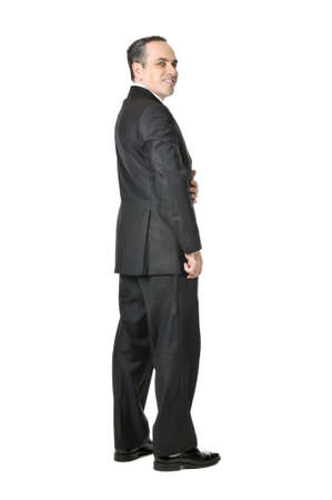 Happy businessman in a suit isolated on white background photo