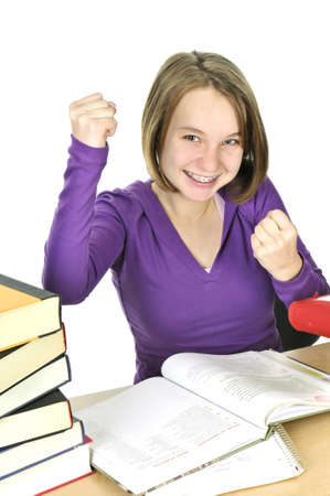 excellent: Happy teenage girl studying at the desk