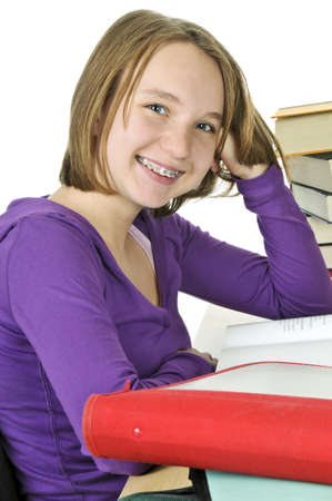 cute braces: Happy teenage girl studying at the desk