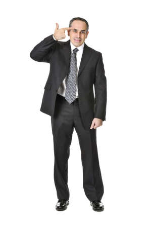 Businessman in a suit gesturing suicide isolated on white background photo