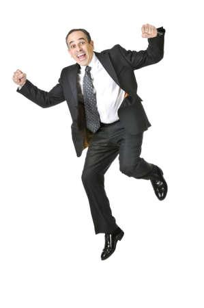 persona saltando: Saltos hombre de negocios en un traje aisladas sobre fondo blanco