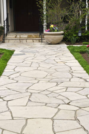 Natural stone path leading to a house, landscaping element photo