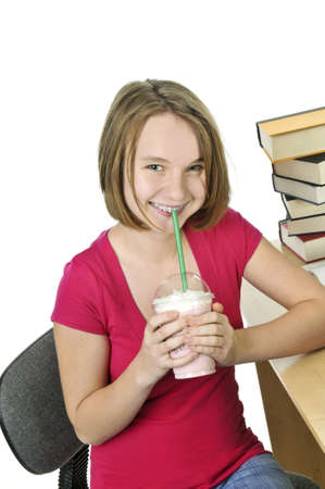 Teenage girl holding a cup with milkshake Stock Photo - 4040578