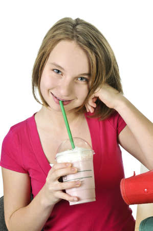 Teenage girl holding a cup with milkshake photo