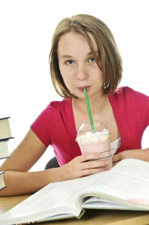 Teenage school girl studying with a milkshake Stock Photo - 4087592