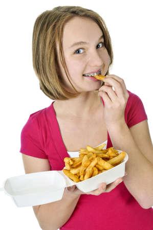 frites: Teenage eating french fries isolated on white background