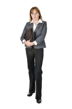 Serious businesswoman holding a portfolio isolated on white background Stock Photo - 4109002