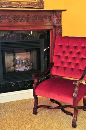 Fireplace and red chair in living room Stock Photo - 4109089