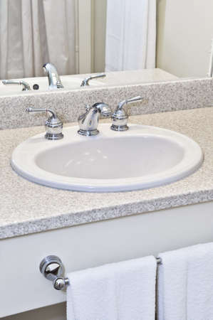 bathroom mirror: Bathroom interior with white sink, faucet and mirror