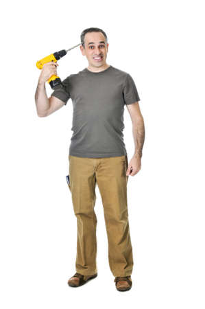 Frustrated handyman putting a drill to his head photo