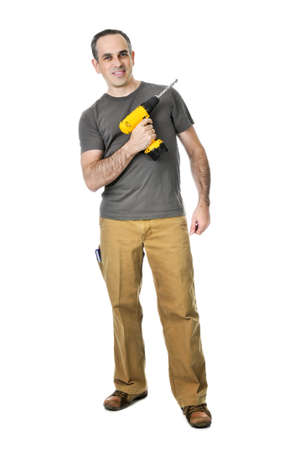 Confident handyman ready to work holding a drill Stock Photo - 4160301