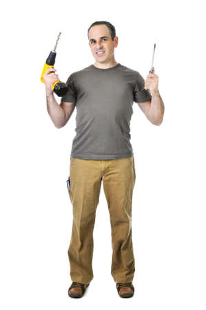 Confident handyman holding a drill and screwdriver Stock Photo - 4160299