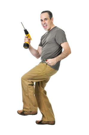Happy handyman doing a dance with his drill Stock Photo - 4160302