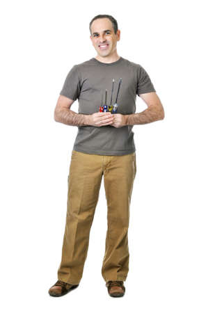 Smiling handyman holding a bunch of screwdrivers Stock Photo - 4160297