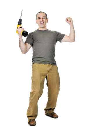 Happy handyman raising his drill in victory Stock Photo - 4160295