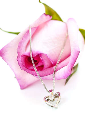 Heart pendant with diamond with a pink rose Stock Photo - 4160270