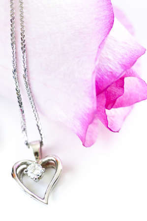 Heart pendant with diamond with a pink rose photo