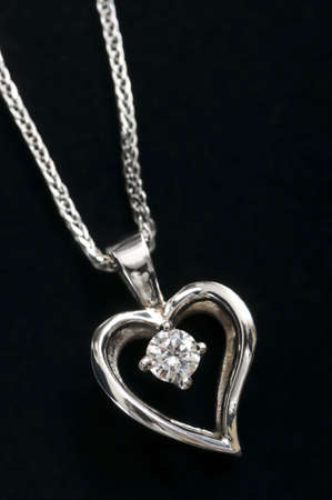 silver jewelry: White gold heart pendant with diamond on a chain