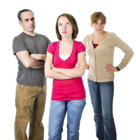 male parent: Teenage girl rolling her eyes in front of angry parents Stock Photo