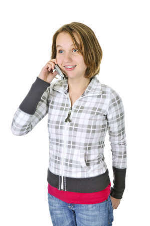 Teenage girl talking on a cell phone isolated on white background Imagens