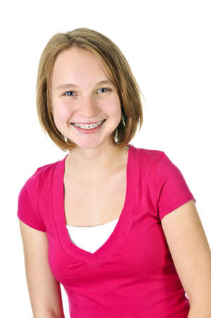 braces: Isolated pretty teenage girl with braces smiling Stock Photo