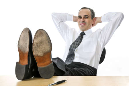 desk: Relaxing businessman with feet up on his desk
