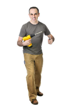 Confident handyman holding a drill and screwdriver Stock Photo - 4184517