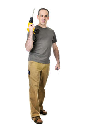 Confident handyman holding a drill and screwdriver Stock Photo - 4184512