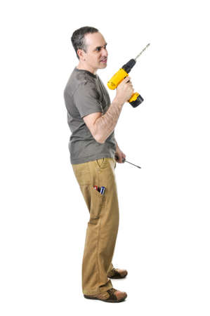 Confident handyman holding a drill and screwdriver Stock Photo - 4184516