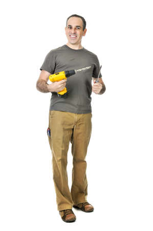 Happy handyman holding a drill and screwdriver Stock Photo - 4184518