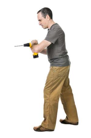 Strong handyman pushing on his cordless drill Stock Photo - 4184528