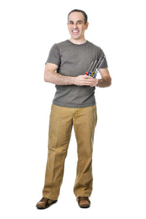 Smiling handyman holding a bunch of screwdrivers Stock Photo - 4184524
