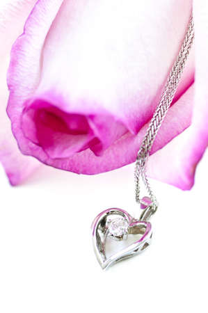 Heart pendant with diamond with a pink rose