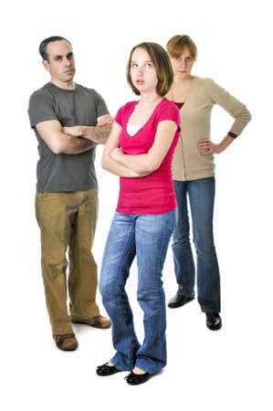 discipline: Teenage girl rolling her eyes in front of angry parents Stock Photo