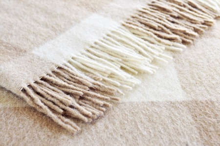 alpaca: Soft and warm folded alpaca wool blanket with fringe