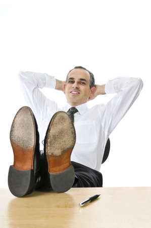 Relaxing businessman with feet up on his desk Stock Photo - 4198082